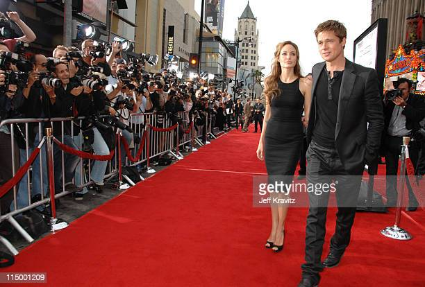 Angelina Jolie and Brad Pitt during 'Ocean's Thirteen' Los Angeles Premiere Red Carpet at Grauman's Chinese Theater in Hollywood California United...