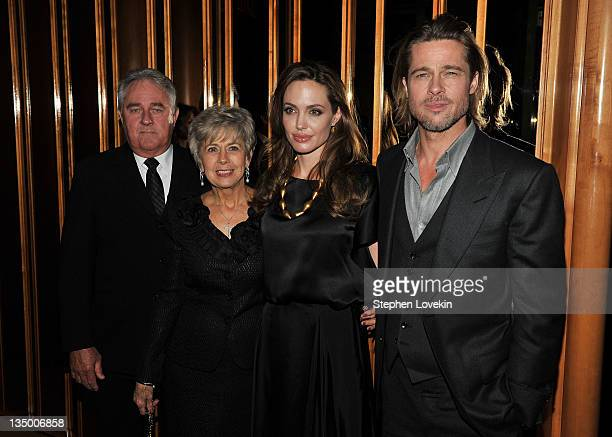 Angelina Jolie and Brad Pitt pose with Bill Ptt and Jane Pitt at the after party for the premiere of In the Land of Blood and Honey at the The...