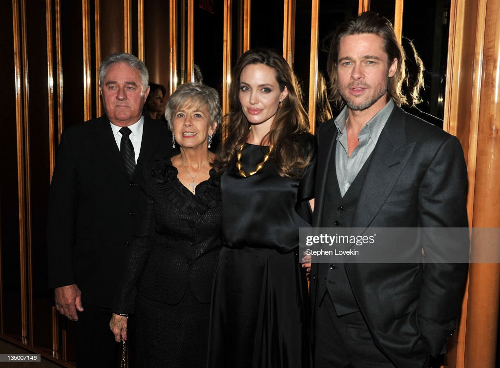 Angelina Jolie and Brad Pitt pose with Bill Ptt and Jane Pitt at the after party for the premiere of 'In the Land of Blood and Honey' at the The Standard Hotel Rooftop on December 5, 2011 in New York City.