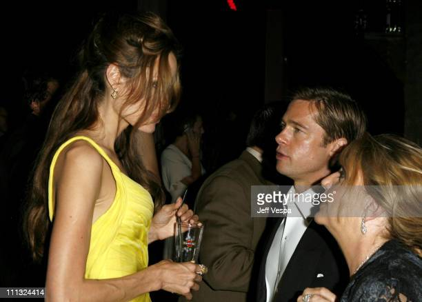 Angelina Jolie and Brad Pitt with guest at the Official Martini Ocean's Thirteen Premiere Party