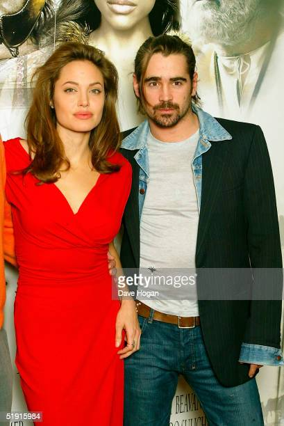 Angelina Jolie and Colin Farrell pose for photographs at the photocall for 'Alexander' at the Dorchester Hotel on January 5, 2005 in London England.