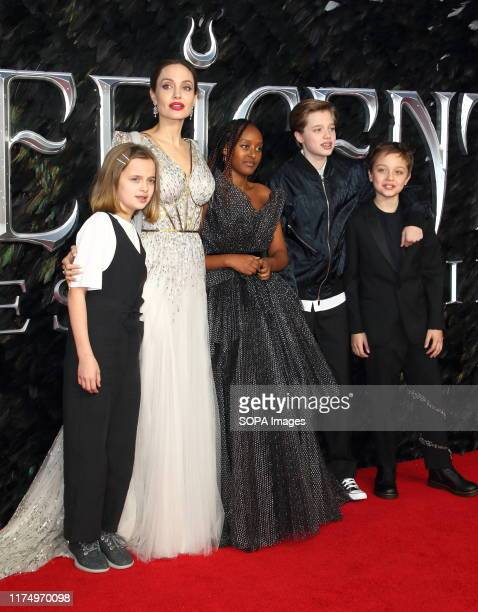 Angelina Jolie and her children Vivienne Zahara Shiloh and Knox attend the Maleficent Mistress of Evil European Film Premiere at the Odeon IMAX...