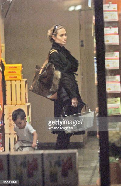 Angelina Jolie and her son Maddox shop around a Whole Foods Store on the Lower Westside December 4 2005 in New York City