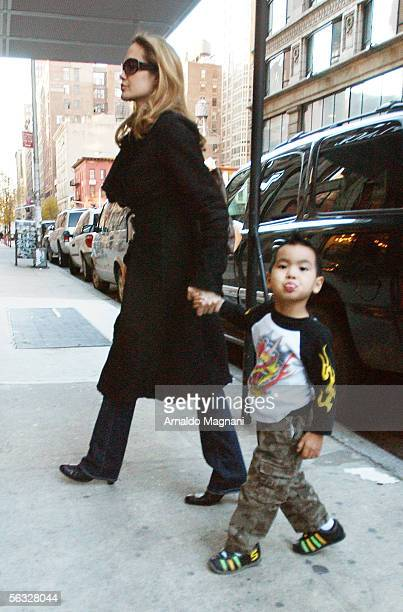 Angelina Jolie and her son Maddox who shows his tongue to photographers as they leave the Antique Showroom on 6th Ave after shopping December 3 2005...