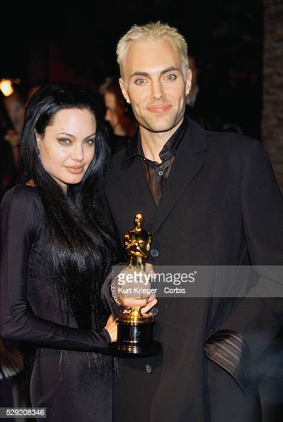 Angelina Jolie and James Haven Voight Holding an Academy Award