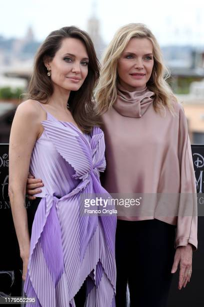 Angelina Jolie and Michelle Pfeiffer attend the photocall of the movie Maleficent – Mistress Of Evil at Hotel De La Ville on October 07 2019 in Rome...