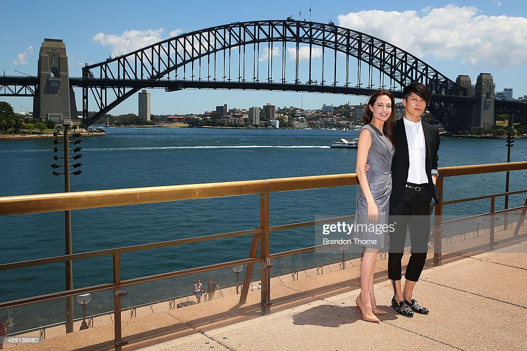 Angelina Jolie and Miyavi Ishihara pose at the photo call of Unbroken at Sydney Opera House on November 18, 2014 in Sydney, Australia.