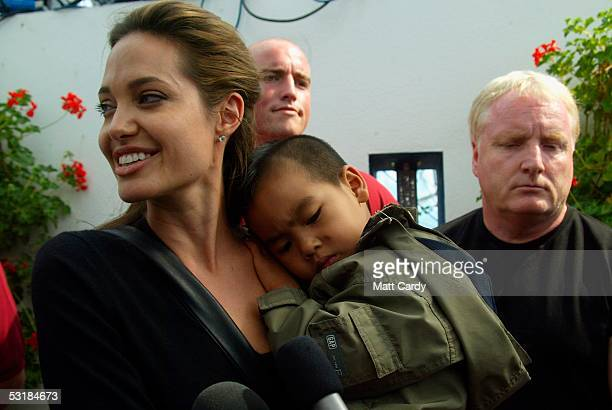 Angelina Jolie and son Maddox walk about during Live 8 Africa Calling hosted by musician Peter Gabriel at The Eden Project on July 2 2005 in St...