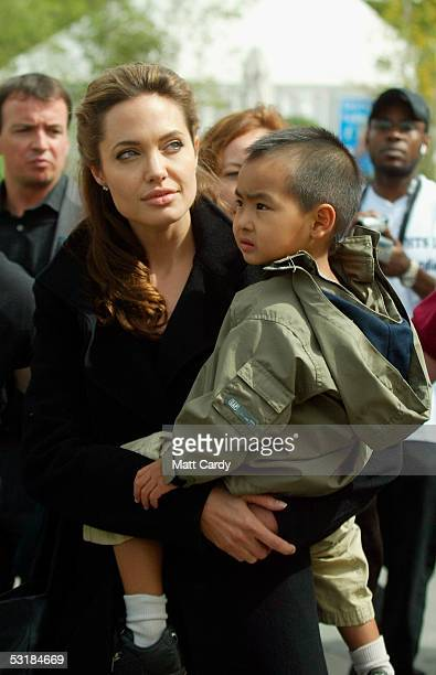 Angelina Jolie and son Maddox walk around during Live 8 Africa Calling hosted by musician Peter Gabriel at The Eden Project on July 2 2005 in St...