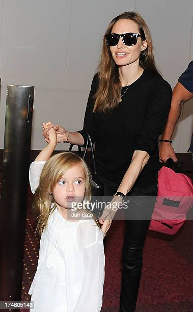Angelina Jolie and Vivienne JoliePitt arrive at Tokyo International Airport on July 28 2013 in Tokyo Japan