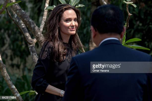 Angelina Jolie arrives at a press conference ahead of the premiere of her new film 'First They Killed My Father' set up at the Raffles Grand Hotel...