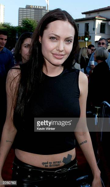Angelina Jolie arrives for the premiere of the film 'Lara Croft Tomb Raider' at Mann Village Theatre in Los Angeles CA Monday June 11 2001