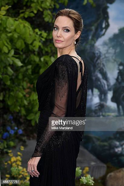 """Angelina Jolie attends a private reception as costumes and props from Disney's """"Maleficent"""" are exhibited in support of Great Ormond Street Hospital..."""
