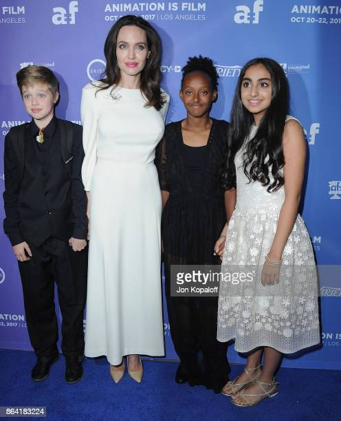 Angelina Jolie daughter Shiloh JoliePitt daughter Zahara JoliePitt and actress Saara Chaudry arrive at the premiere of Gkids' 'The Breadwinner' at...