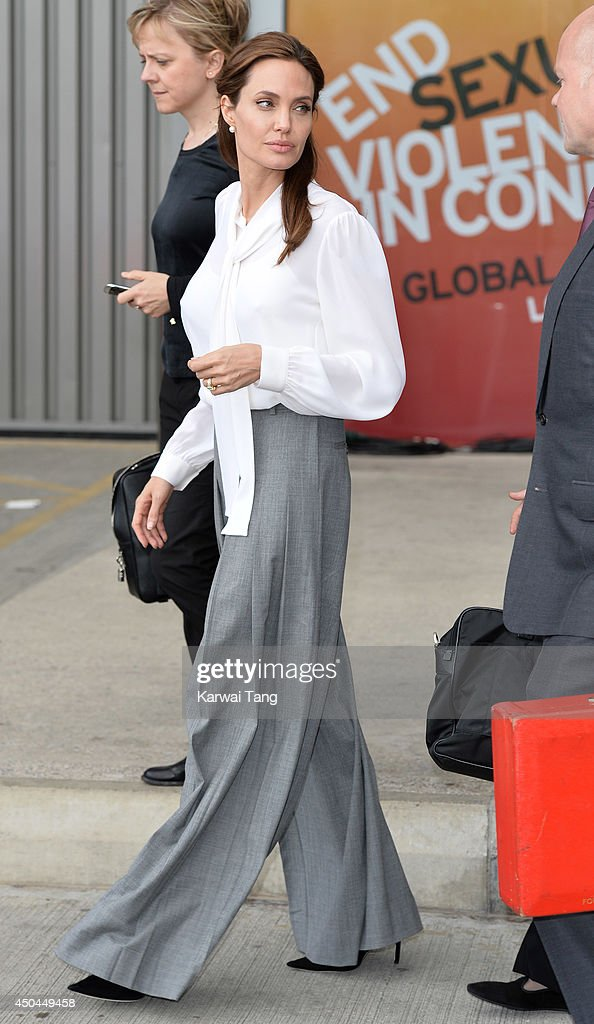 Angelina Jolie departs after attending a special screening of 'The Land of Blood and Honey' during the Global Summit to end Sexual Violence in Conflict at ExCel on June 11, 2014 in London, England.