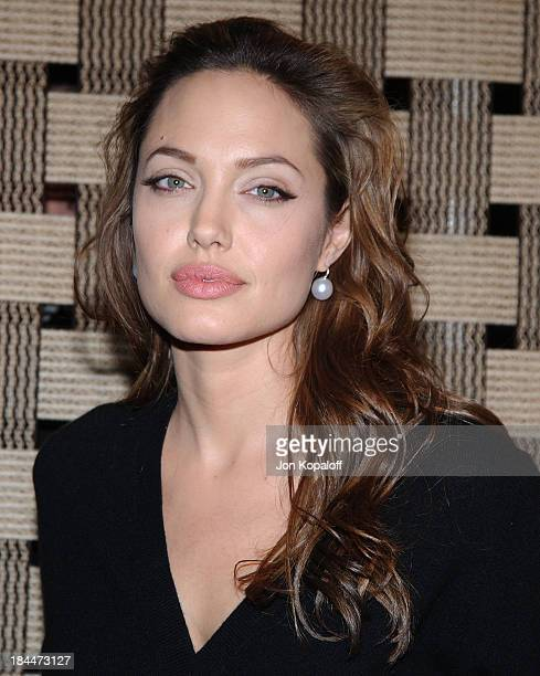 Angelina Jolie during 'Hotel Rwanda' Los Angeles Premiere Arrivals at Academy Theatre in Beverly Hills California United States
