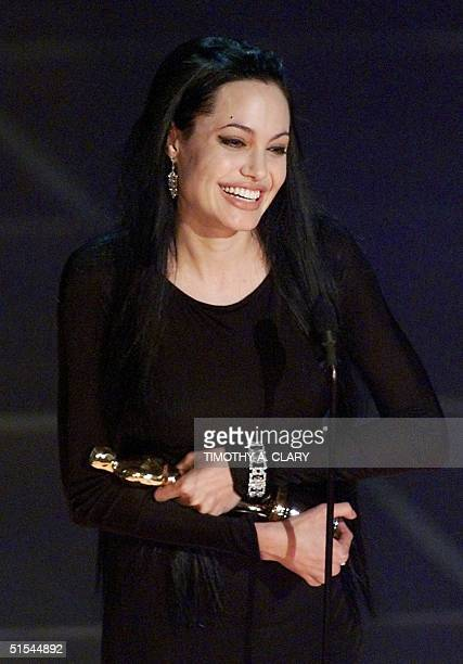 Angelina Jolie holds her Oscar for Best Performance by a Supporting Actress in a Leading Role during the 72nd Academy Awards 26 March 2000 at the...