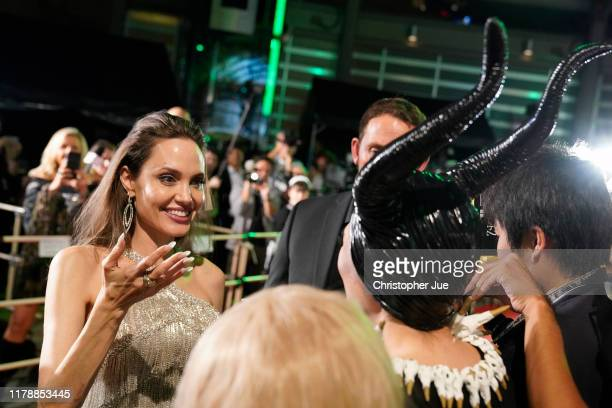 Angelina Jolie interacts with fans at the Japan premiere of 'Maleficent: Mistress of Evil' on October 03, 2019 in Tokyo, Japan.