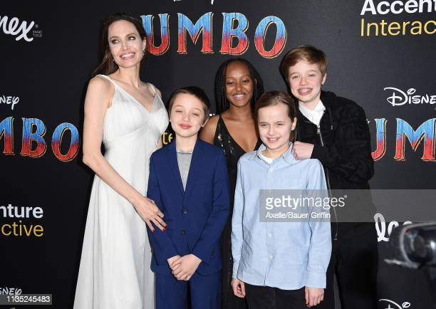 Angelina Jolie, Knox Leon Jolie-Pitt, Zahara Marley Jolie-Pitt, Vivienne Marcheline Jolie-Pitt, and Shiloh Nouvel Jolie-Pitt attend the premiere of...