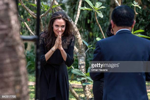 Angelina Jolie leaves a press conference ahead of the premiere of her new film 'First They Killed My Father' set up at the Raffles Grand Hotel...