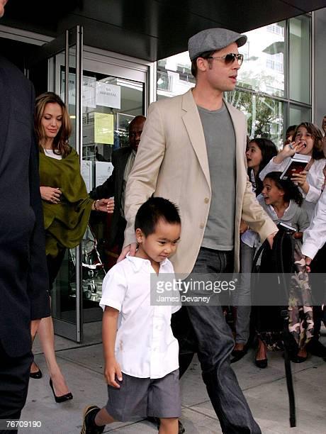 Angelina Jolie Maddox JoliePitt and Brad Pitt walk past a waiting crowd on September 12 2007 in New York City