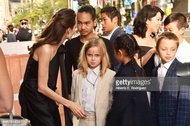 Angelina Jolie Maddox JoliePitt Vivienne JoliePitt Pax JoliePitt Sareum Srey Moch Loung Ung Knox JoliePitt and Kimhak Mun attend the First They...