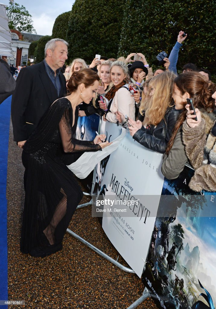 Angelina Jolie meets fans at a private reception as costumes and props from Disney's 'Maleficent' are exhibited in support of Great Ormond Street Hospital at Kensington Palace on May 8, 2014 in London, England.