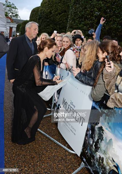 """Angelina Jolie meets fans at a private reception as costumes and props from Disney's """"Maleficent"""" are exhibited in support of Great Ormond Street..."""