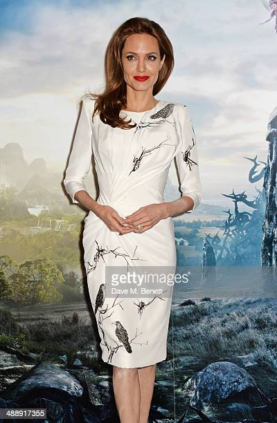 Angelina Jolie poses at a photocall for 'Maleficent' at the Corinthia Hotel London on May 9 2014 in London England