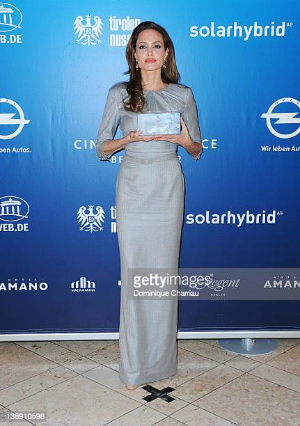 Angelina Jolie poses with her award at the Winners Boards during the Cinema for Peace Gala at the Konzerthaus Am Gendarmenmarkt during day five of...