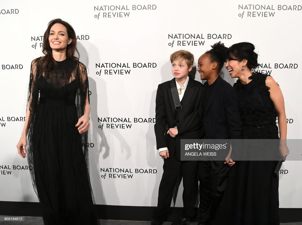 TOPSHOT - (L-R) Angelina Jolie, Shiloh Jolie-Pitt, Zahara Jolie-Pitt, and Loung Ung attend the 2018 National Board of Review Awards Gala at Cipriani 42nd Street on January 9, 2018 in New York City. /