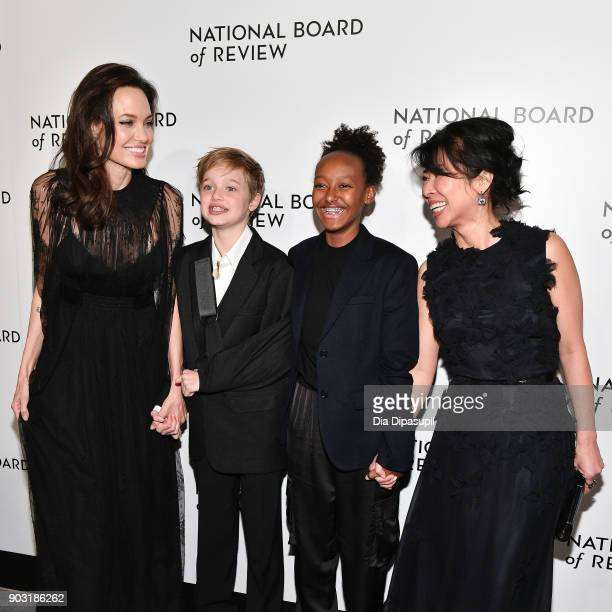 Angelina Jolie, Shiloh Jolie-Pitt, Zahara Jolie-Pitt, and Loung Ung attend the 2018 National Board of Review Awards Gala at Cipriani 42nd Street on...
