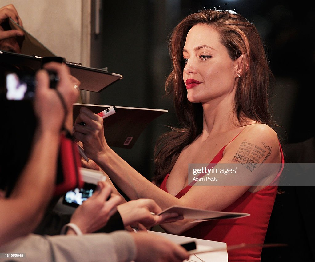 Angelina Jolie signs autographs on the red carpet during the 'Moneyball' Japan Premiere at Tokyo International Forum on November 9, 2011 in Tokyo, Japan.