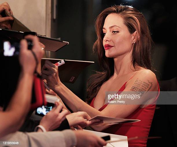 Angelina Jolie signs autographs on the red carpet during the 'Moneyball' Japan Premiere at Tokyo International Forum on November 9 2011 in Tokyo Japan