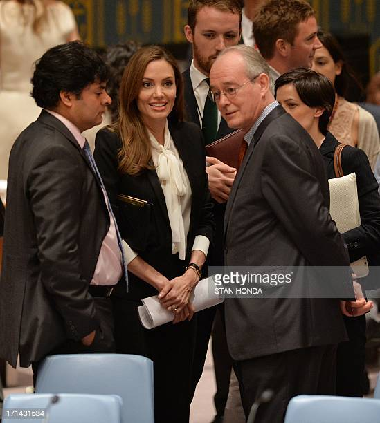 Angelina Jolie Special Envoy United Nations High Commissioner for Refugees speaks with diplomats before a United Nations Security Council meeting on...