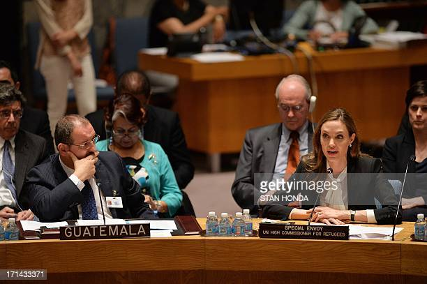 Angelina Jolie Special Envoy United Nations High Commissioner for Refugees speaks as Fernando Carrera Guatemala's Ambassador to the UN looks on...