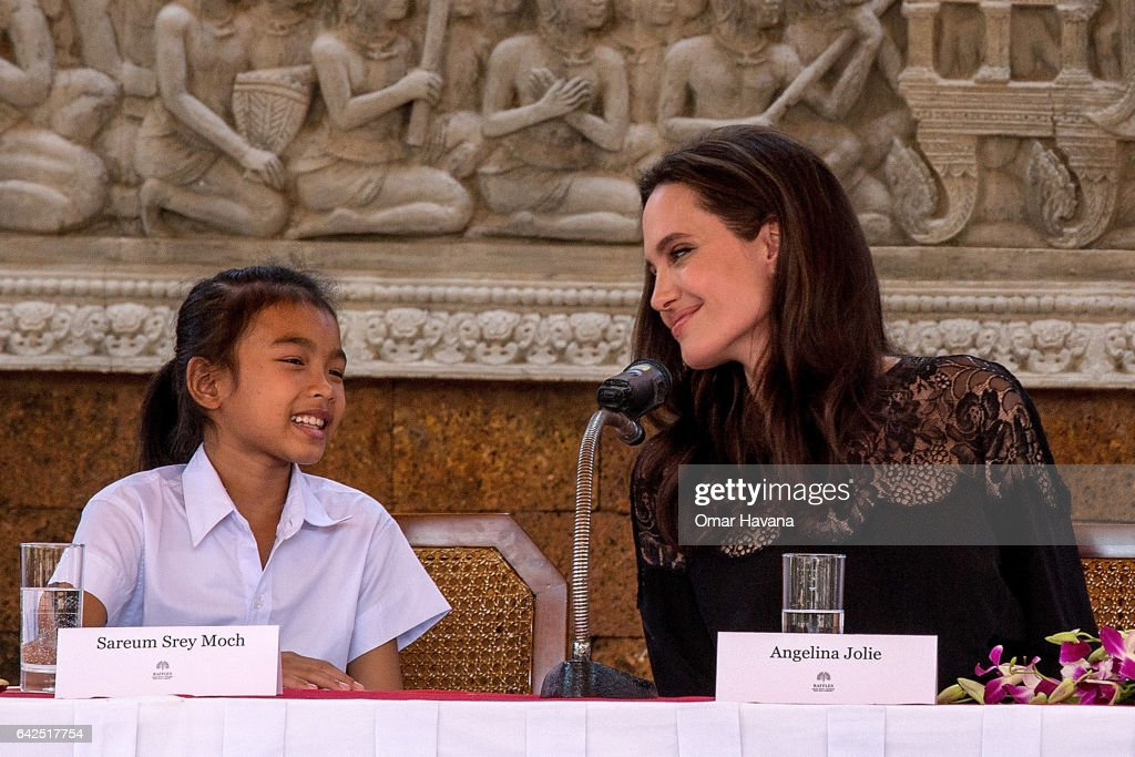 Angelina Jolie (right) talks to actress Sareum Srey Moch (left) during a press conference ahead of the premiere of their new movie 'First They Killed My Father' set up at the Raffles Grand Hotel D'Angkor on February 18, 2017 in Siem Reap, Cambodia. Angelina Jolie is in Siem Reap for the world premiere of her new movie, 'First They Killed my Father,' a Netflix-produced adaption of the autobiography by the same name penned by Loung Ung, who lived through the Khmer Rouge regime as a young child. The film will be screened Saturday night in the Angkor Wat temple complex, and released later this year on Netflix.