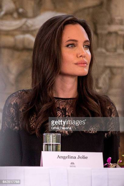 Angelina Jolie talks to press during a press conference ahead of the premiere of her new movie 'First They Killed My Father' set up at the Raffles...