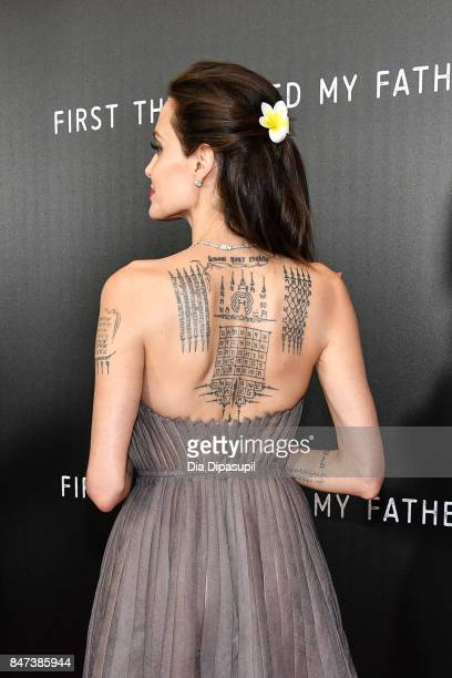 Angelina Jolie tattoo detail attends the First They Killed My Father New York premiere at DGA Theater on September 14 2017 in New York City