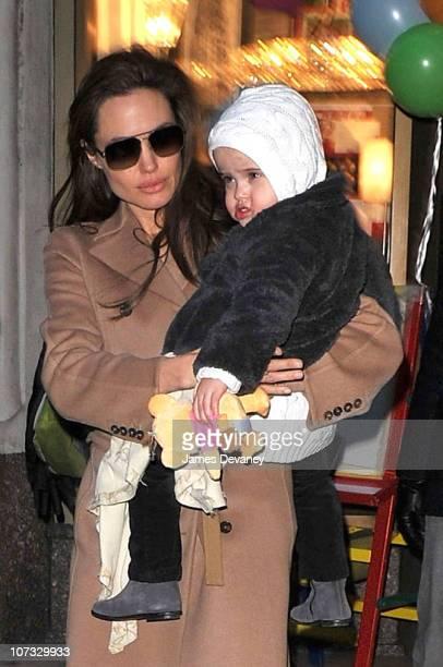 Angelina Jolie visits Lee's Art Shop with Vivienne JoliePitt on December 4 2010 in New York City