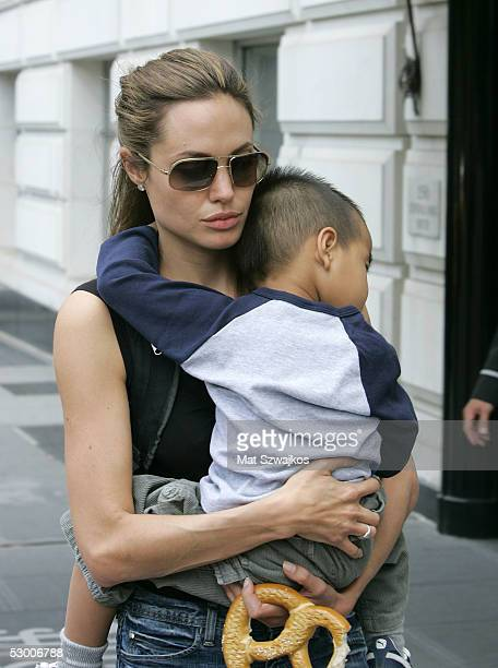 Angelina Jolie walks down the street while carrying her son Maddox June 1 2005 in New York City