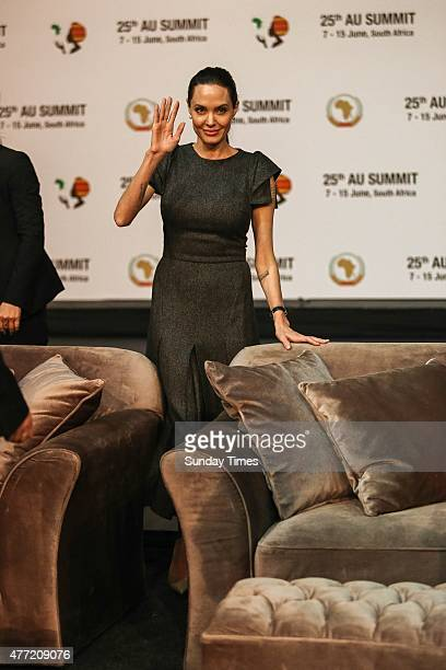 Angelina Jolie waves to the audience before her address at the 25th AU summit 2015 on June 12, 2015 at Sandton Convention Centre in Johannesburg,...