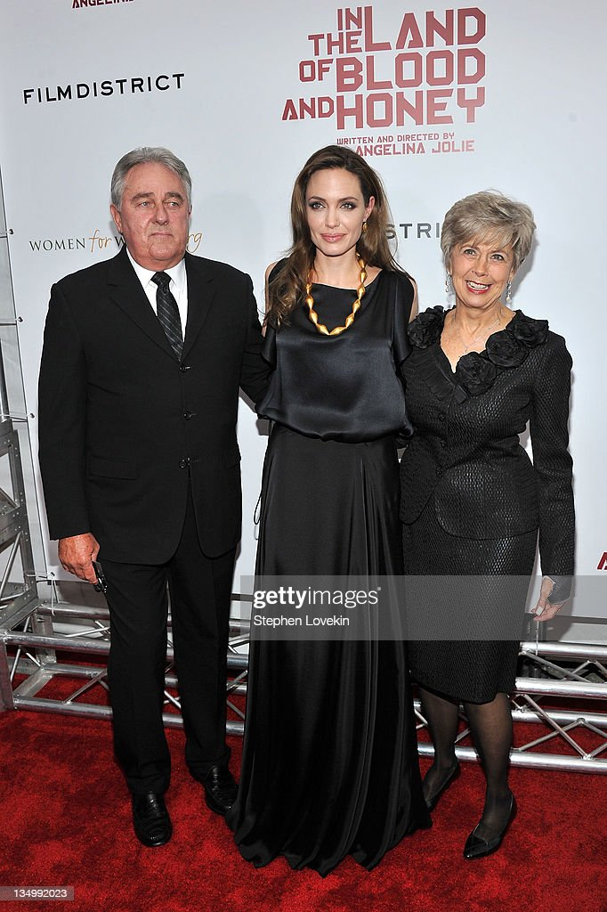 Angelina Jolie (center) with Bill Pitt and Jane Pitt attend the premiere of 'In the Land of Blood and Honey' at the School of Visual Arts on December 5, 2011 in New York City.