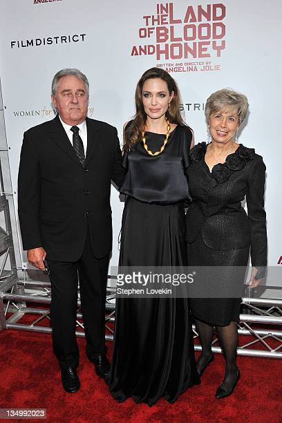 Angelina Jolie with Bill Pitt and Jane Pitt attend the premiere of In the Land of Blood and Honey at the School of Visual Arts on December 5 2011 in...