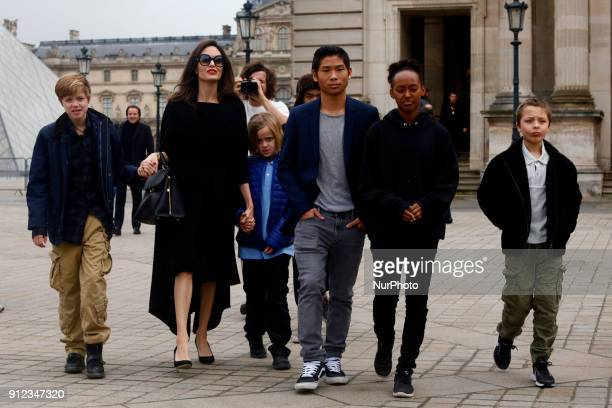 Angelina Jolie with her children Shiloh Maddox Vivienne Marcheline Pax Thien Zahara Marley Knox Leon visit the Louvre in Paris France on January 30...