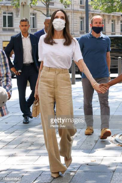 """Angelina Jolie,Pax Thien Jolie,Zahara-Marley Jolie and Knox-Leon Jolie are seen arriving at the """"Guerlain"""" store on the champs Elysees on July 22,..."""