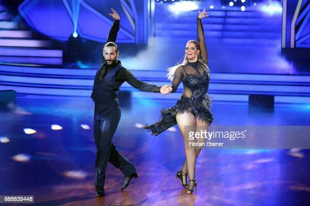 Angelina Kirsch and Massimo Sinato perform on stage during the 10th show of the tenth season of the television competition 'Let's Dance' on May 26...