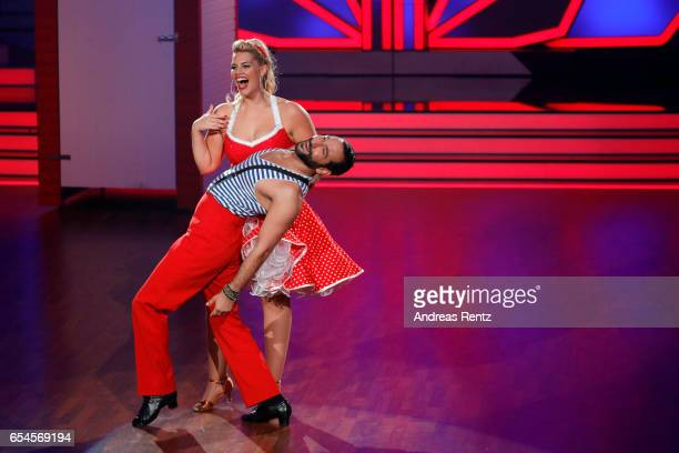 Angelina Kirsch and Massimo Sinato perform on stage during the 1st show of the tenth season of the television competition 'Let's Dance' on March 17...