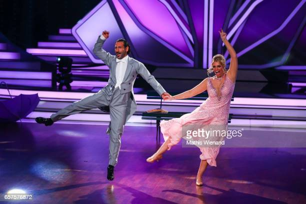 Angelina Kirsch and Massimo Sinato perform on stage during the 2nd show of the tenth season of the television competition 'Let's Dance' on March 24...