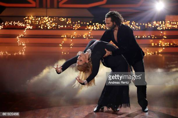 Angelina Kirsch and Massimo Sinato perform on stage during the 3rd show of the tenth season of the television competition 'Let's Dance' on March 31...